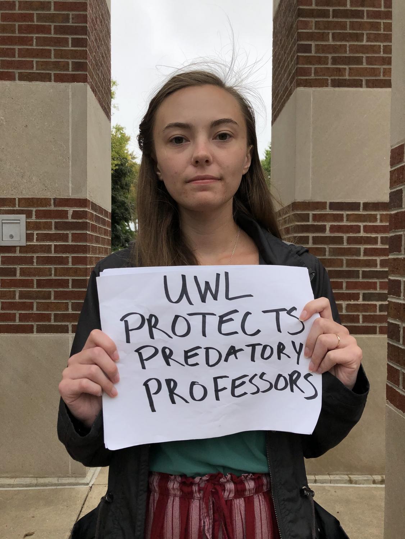 UWL Senior Kendra Whelan protesting by Hoeschler Clock Tower