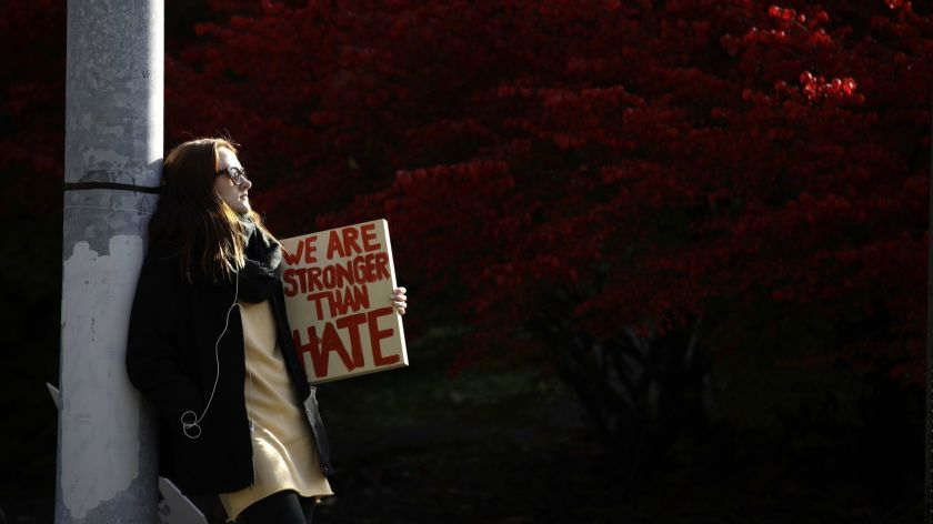 A demonstrator waits for the start of a protest in the aftermath of the mass shooting at Pittsburgh's Tree of Life Synagogue late last month. Photo by Matt Rourke, AP News.