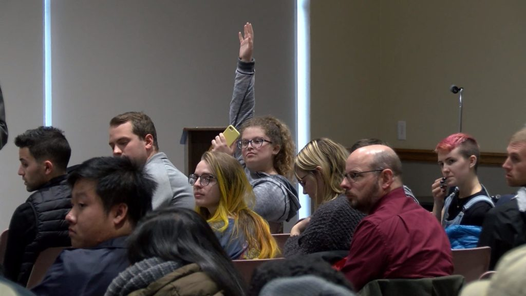 UWL Senior Alyson Young waits to ask a question to Chancellor Gow at his annual open forum. Photo retrived by WXOW.