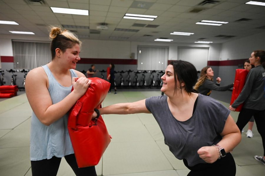 Students learning defense tactics in self-defense class. Photo taken by Carly Rundle-Borchert.