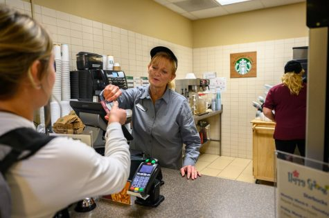 Tammy Larkin (left) and Lisa Kumm (right) working in the Starbucks located in Centennial Hall.