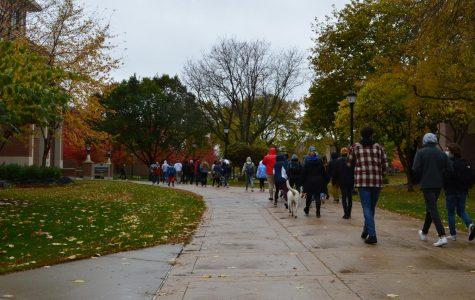UWL students march through campus on their way to City Hall. (Photo taken by Maija Sikora).