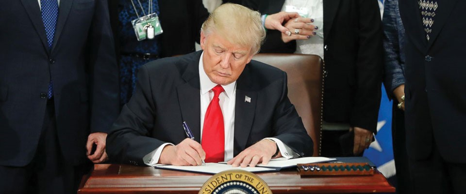 President Trump signing the executive order to suspend entry to the U.S from seven countries.