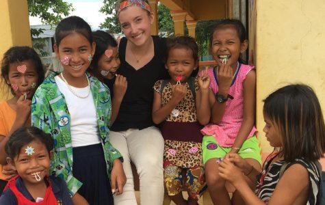 UWL Junior Margaret Finco with children in Cambodia