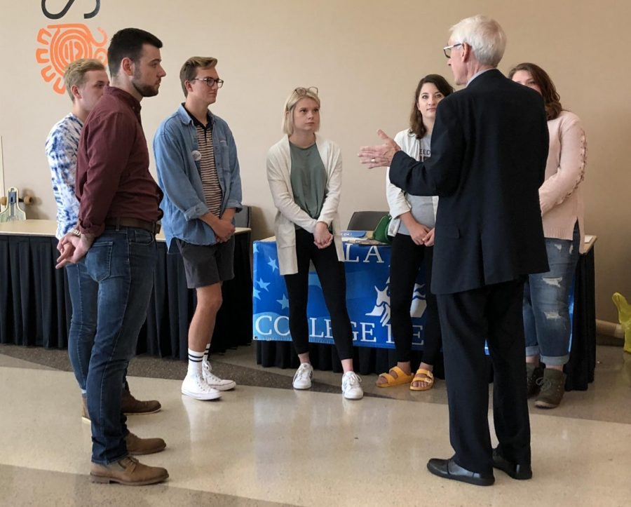 Gubernatorial candidate Tony Evers (D) speaks with UWL students