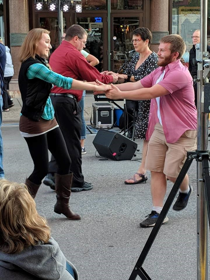 Klum dancing at Swinin' in the Streets in Winona, Minnesota. Photo via https://uwlmyorgs.campuslabs.com/engage /organization/ballroomandswing/gallery /album/199454