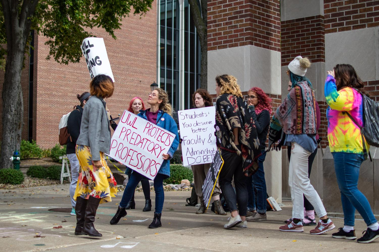 UWL students protesting at the Clock Tower in result of recent sexual misconduct allegations on campus. Photo by Carly Rundle-Borchert