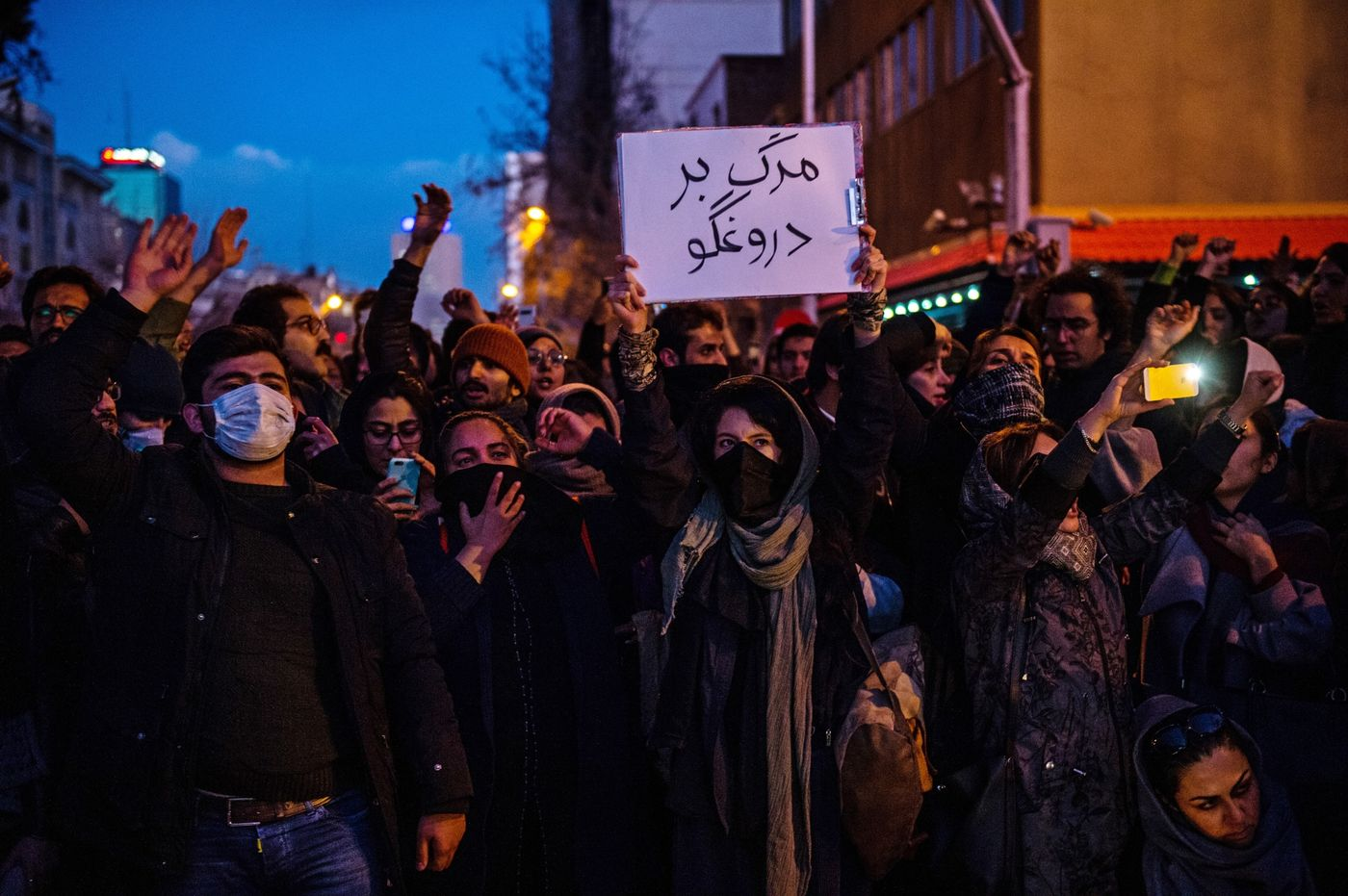 Protestors chant during a vigil for the victims of the Ukraine International Airlines flight Tehran.