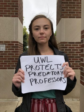 "UWL student Kendra Whelan protests with a sign ""UWL Protects Predatory Professors."""
