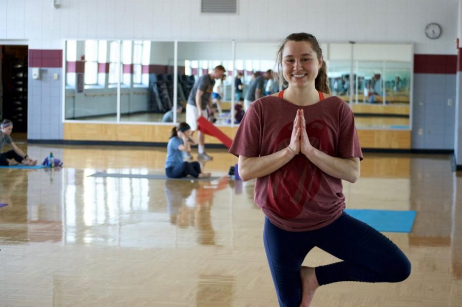 Yoga+instructor+Lizzy+Schneider+poses+for+a+photo+in+the+rec+room