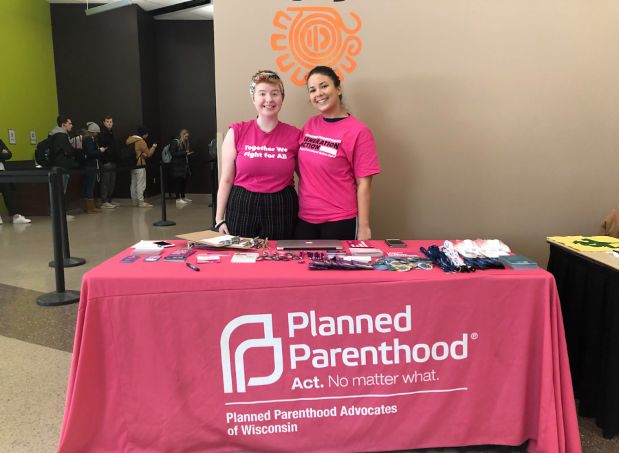 K.C. Cayo (left) and Kristin Mitchell (right) tabling for Planned Parenthood Advocates of Wisconsin. Photo by Sam Stroozas.