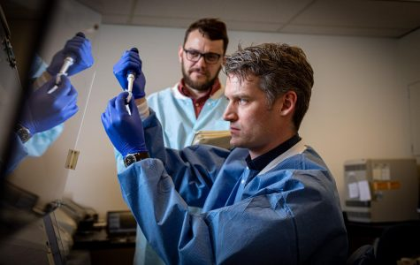 Peter Thielen, front, works with Tom Mehoke on immediate sequencing of the SARS-CoV-2 genome, the virus that causes COVID-19, at the Johns Hopkins Hospital molecular diagnostics laboratory.