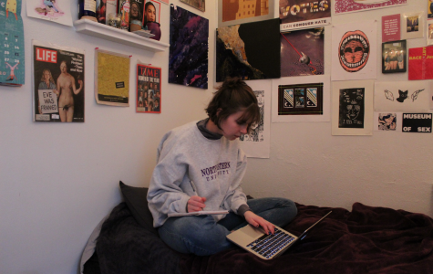 Sam Stroozas working on an article in her bedroom in La Crosse.