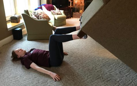 Lauren Young doing leg presses with her couch. Photo submitted by Lauren Young.