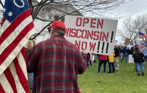 Protester at the Wisconsin Capital. Photo retrieved from WTMJ-TV, TMJ4 Milwaukee.