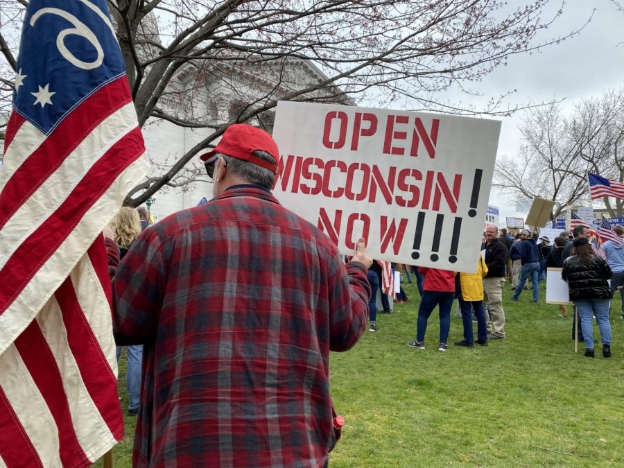 Protester+at+the+Wisconsin+Capital.+Photo+retrieved+from+WTMJ-TV%2C+TMJ4+Milwaukee.