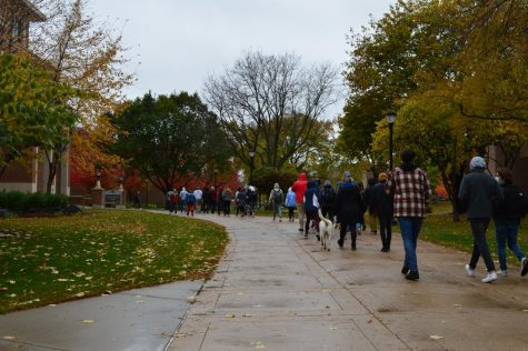 UWL students march through campus on their way to City Hall. (Photo taken by Maija Sikora).